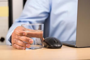 Man with Water in Office